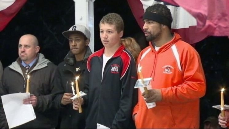 Isaac Phillips, center, leads an anti-racism candlelight vigil in Lunenburg — ABC News screenshot