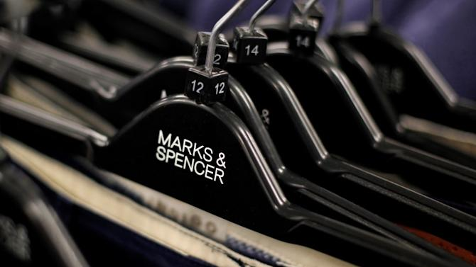 Clothes are displayed on hangers in an M&S shop in northwest London