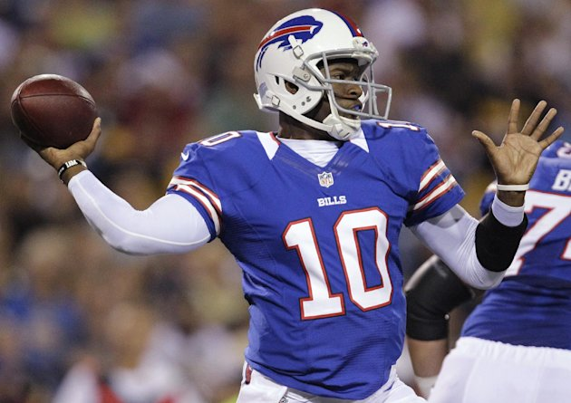 File - In this Aug. 25, 2012 file photo, Buffalo Bills' Vince Young throws against the Pittsburgh Steelers during the second half of a preseason NFL football game in Orchard Park, N.Y. Six years after entering the NFL as the third player taken in the draft, Vince Young finds himself without a team and with only a fraction of the money he received from a contract that paid him a guaranteed $26 million. (AP Photo/Gary Wiepert, File)