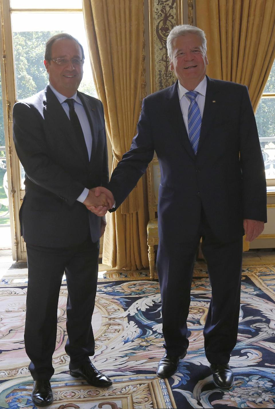 French President Francois Hollande left, and German President Joachim Gauckand meet at the Elysee Palace in Paris, Tuesday, Sept. 3, 2013. Gauckand is on a two-day state visit in France. (AP Photo/Jacques Brinon, Pool)