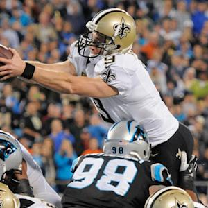 New Orleans Saints quarterback Drew Brees leaps for 1-yard TD
