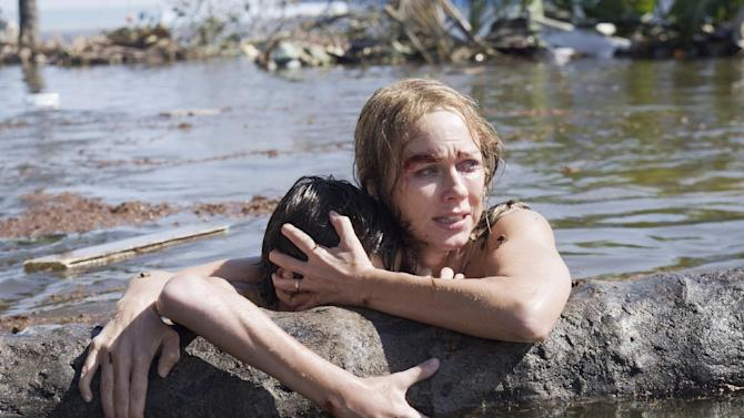 """This film image released by Summit Entertainment shows Tom Holland, left, and Naomi Watts in a scene from """"The Impossible."""" Watts was nominated  for an Academy Award for best actress on Thursday, Jan. 10, 2013, for her role in the film. The 85th Academy Awards will air live on Sunday, Feb. 24, 2013 on ABC.  (AP Photo/Summit Entertainment, Jose Haro)"""