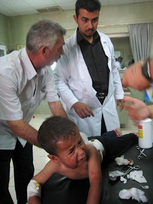An injured boy is treated at a hospital after a car bomb in Kirkuk, 290 kilometers (180 miles) north of Baghdad, Iraq, Monday, May 23, 2011. Iraqi police say a car bomb has exploded in a northern city that is rife with ethnic tensions, killing and wounding several bystanders.(AP Photo/Emad Matti)