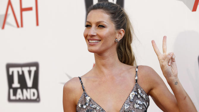 "FILE - In this June 9, 2011 file photo, Gisele Bundchen arrives at the taping of ""TV Land Presents: AFI Life Achievement Award Honoring Morgan Freeman"" in Culver City, Calif. Bundchen, supermodel and wife of New England Patriots quarterback Tom Brady, was stopped for speeding over the weekend and given a verbal warning by a Massachusetts state trooper. (AP Photo/Matt Sayles, File)"