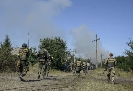 Ukrainian servicemen are seen during fighting with pro-Russian separatists in the eastern Ukrainian town of Ilovaysk