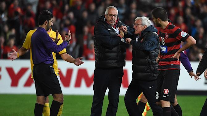 Guangzhou Evergrande coach Marcello Lippi (2/R) is restrained as he confronts the referee after having a second player sent off against Western Sydney Wanderers during their AFC Champions League quarter-final in Sydney