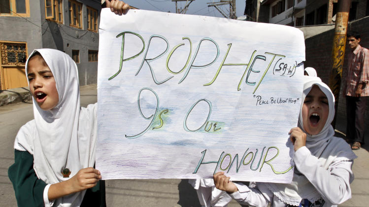 "Kashmiri Muslim students shout slogans during a protest rally against an anti-Islam film called ""Innocence of Muslims"" that ridicules Islam's Prophet Muhammad in Srinagar, India, Saturday, Sept. 22, 2012. (AP Photo/Mukhtar Khan)"