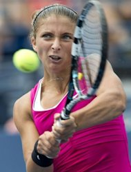 Sara Errani of Italy hits a return to Angelique Kerber of Germany during their women's singles match at the 2012 US Open tennis tournament in New York. Errani won 7-6 (7/5), 6-3