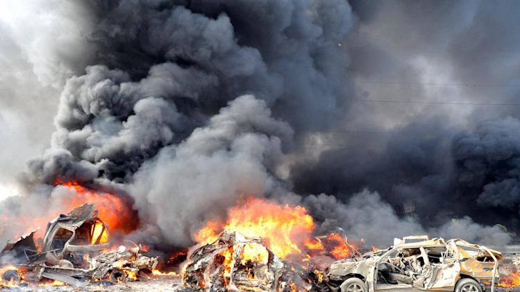 DAMASCUS: In this photo released by the Syrian official news agency SANA, flames and smoke raise from burning cars after two bombs exploded, at Qazaz neighborhood in Damascus, Syria, on Thursday May 10, 2012.  Two large explosions ripped through the Syrian capital Thursday, heavily damaging a military intelligence building and leaving blood and human remains in the streets. AP/PTI (AP5_10_2012_000021B)