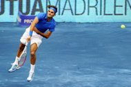 Swiss Roger Federer serves to Serbian Janko Tipsarevic during their semi-final tennis match of the Madrid Masters. Federer won 6-2, 6-3