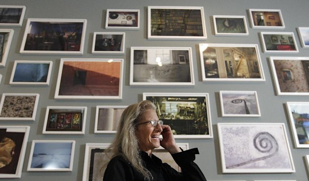 "Annie Leibovitz answers questions during an interview before the opening of her exhibition at the Wexner Center for the Arts Friday, Sept. 21, 2012, in Columbus, Ohio. Leibovitz's exhibition features work from her ""Master Set,"" an authoritative edition of 156 images. (AP Photo/Jay LaPrete)"