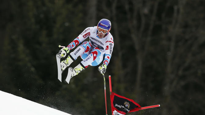 France's Adrien Theaux competes during an alpine ski, men's World Cup downhill training session in Garmish Partenkirchen, Germany, Friday, Feb. 27, 2015. (AP Photo/Marco Trovati)