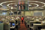 This file photo shows the floor of the Hong Kong Stock Exchange, pictured on April 24. Chinese brokerage Haitong Securities fell on its Hong Kong trading debut on Friday after raising $1.68 billion from a share sale, the world's largest IPO so far this year
