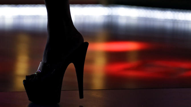 """In this Aug. 16, 2012 photo, an entertainer performs at the """"Mons Venus"""" adult club in Tampa, Fla. The club _ located less than 6 miles from where the Republicans will gather to nominate former Massachusetts Gov. Mitt Romney as their presidential candidate _ was opened 30 years ago by Joe Redner, who almost single-handedly made Tampa's adult entertainment world famous. (AP Photo/Chris O'Meara)"""