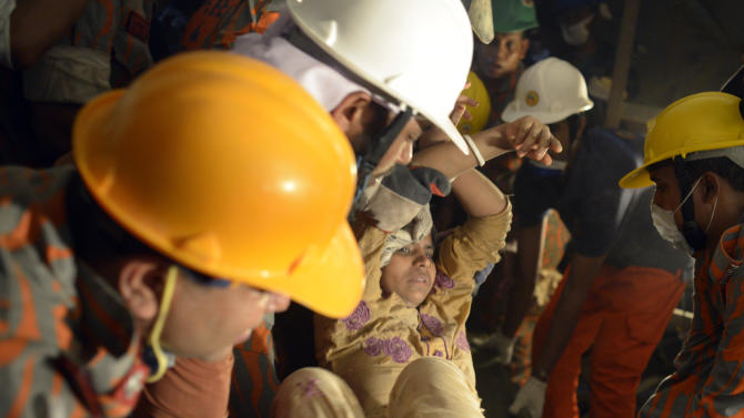 Rescue workers evacuate a survivor from the garment factory building that collapsed Wednesday,  in Savar, near Dhaka, Bangladesh, Saturday, April 27, 2013. Police in Bangladesh took five people into custody in connection with the collapse of a shoddily-constructed building this week, as rescue workers pulled 19 survivors out of the rubble on Saturday and vowed to continue as long as necessary to find others despite fading hopes. (AP Photo/Ismail Ferdous)