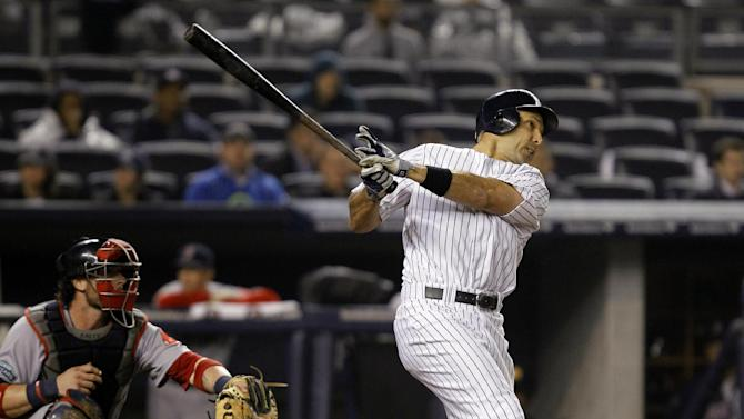New York Yankees' Raul Ibanez hits a ninth-inning, two-run home run against the Boston Red Sox during their baseball game at Yankee Stadium in New York, Tuesday, Oct. 2, 2012. (AP Photo/Kathy Willens)