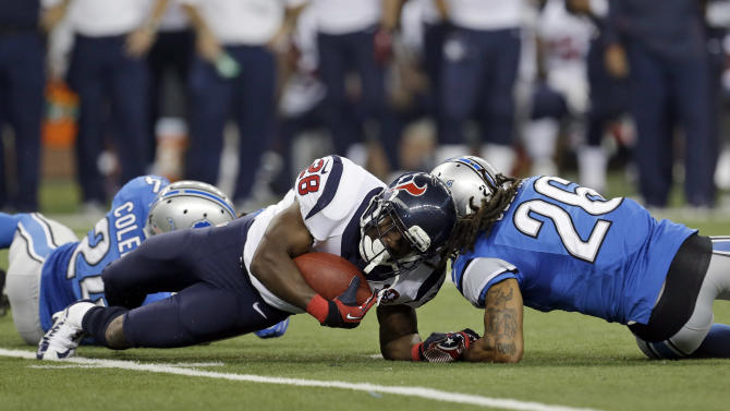 Houston Texans running back Justin Forsett (28) is hit by Detroit Lions free safety Louis Delmas (26) during the third quarter of an NFL football game at Ford Field in Detroit, Thursday, Nov. 22, 2012. Forsett scored an 81-yard touchdown run on the play. (AP Photo/Paul Sancya)