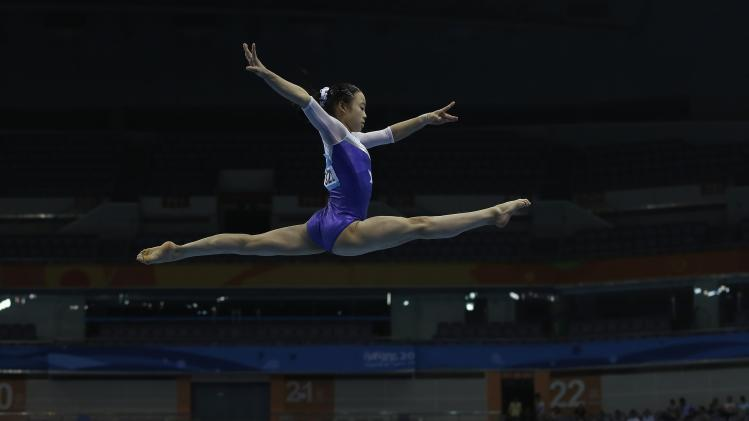 Japan's Miyakawa competes during the artistic gymnastics women's all-around final match at the 2014 Nanjing Youth Olympic Games in Nanjing