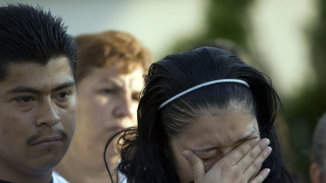 Johana Portillo-Lopez, daughter of Ricardo Portillo, who passed away after injuries he sustained after an assault by a soccer player at a soccer game he was refereeing on April 27, becomes emotional as she speaks about her father's death during a press conference in Salt Lake City on Sunday, May 5, 2013. (AP Photo/The Salt Lake Tribune, Kim Raff)