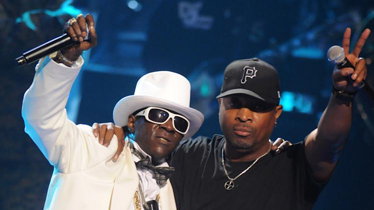 """FILE - This Sept. 23, 2009 file photo shows Rappers Flavor Flav, left, and Chuck D of the music group Public Enemy, perform at the 2009 VH1 Hip Hop Honors at the Brooklyn Academy of Music, in New York. The eclectic group of rockers Rush and Heart, rappers Public Enemy, songwriter Randy Newman, """"Queen of Disco"""" Donna Summer and bluesman Albert King will be inducted into the Rock and Roll Hall of Fame next April in Los Angeles. The inductees were announced Tuesday by 2012 inductee Flea of The Red Hot Chili Peppers at a news conference in Los Angeles. (AP Photo/Peter Kramer, file)"""