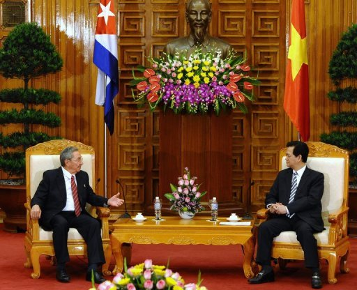 Cuban President Raul Castro (left) and Vietnamese Prime Minister Nguyen Tan Dung meet at the presidential palace in Hanoi on Sunday. Castro met with Vietnamese leaders following a visit to China, as Havana looks to old communist allies while it attempts to push through historic economic reforms