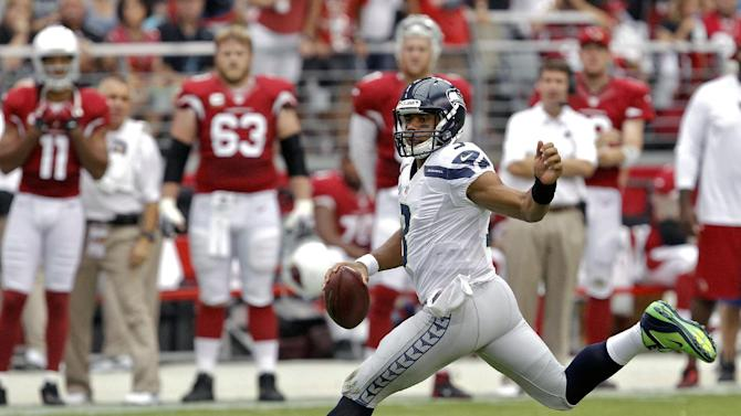 Seattle Seahawks quarterback Russell Wilson scrambles against the Arizona Cardinals during the first half of an NFL football game on Sunday, Sept. 9, 2012,in Glendale, Ariz. (AP Photo/Ross D. Franklin)