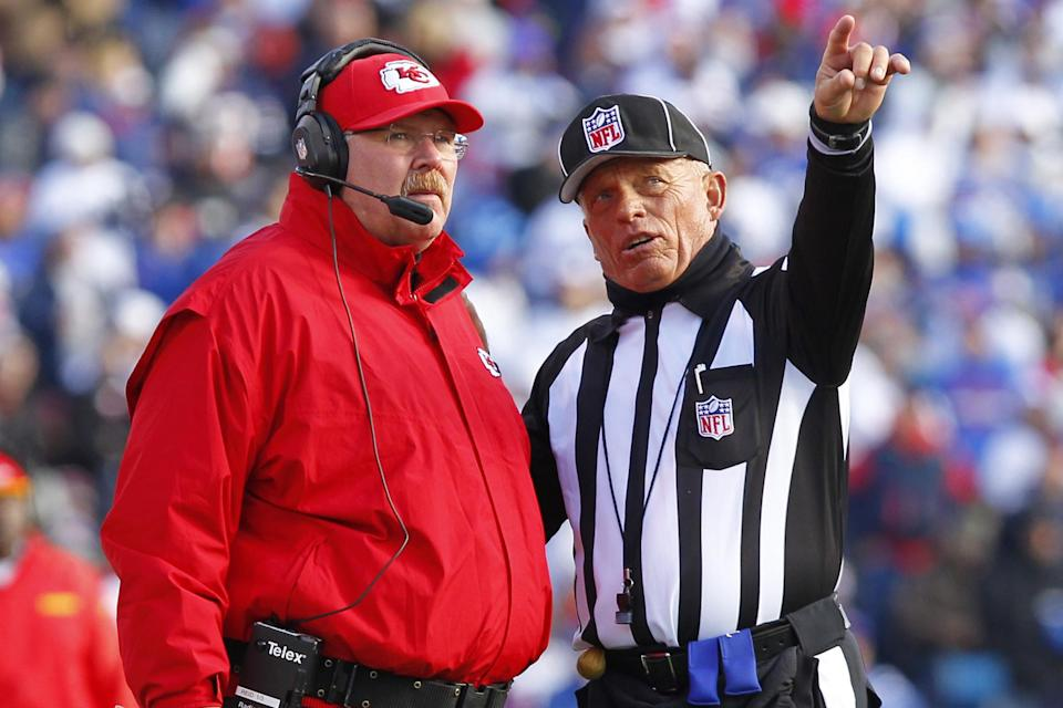 Kansas City Chiefs head coach Andy Reid, left, talks with side judge Tom Hill during the second quarter of an NFL football game in Orchard Park, N.Y., Sunday, Nov. 3, 2013. (AP Photo/Bill Wippert)