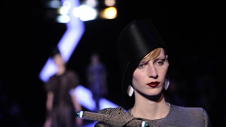 Armani mixes classic couture with exotic panache