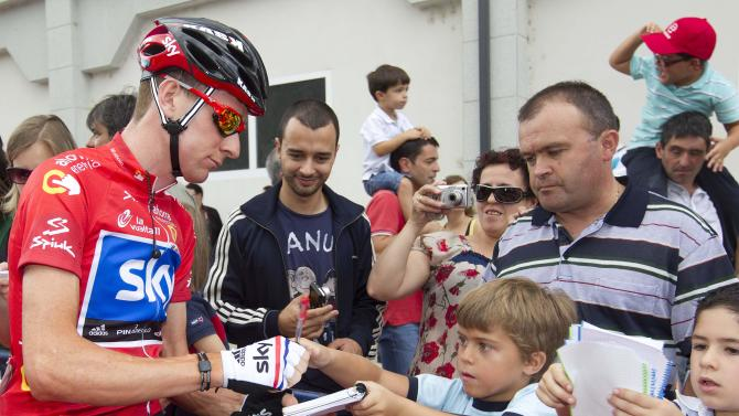 Current race leader Bradley Wiggins of Britain signs autographs before the start of the13th stage of the Spanish Vuelta cycling race in Sarria, Spain Friday Sept. 2, 2011. (AP Photo/Lalo R. Villar)
