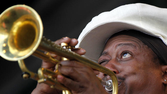 Kermit Ruffins performs at the New Orleans Jazz and Heritage Festival in New Orleans, Sunday, May 6, 2012.  (AP Photo/Gerald Herbert)