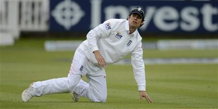 England's captain Alastair Cook is seen on the ground during the first test cricket match against New Zealand at Lord's cricket ground in London