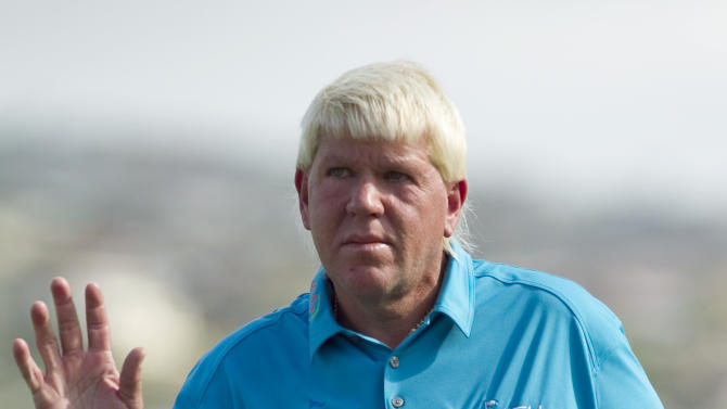 John Daly waves to the gallery after he made a birdie putt on the 18th green during the second round of the Sony Open golf tournament, Friday, Jan. 11, 2013, in Honolulu. (AP Photo/Marco Garcia)
