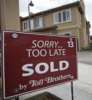 "FILE - In this May 23, 2011 file photo, a sold sign is posted at a new town home luxury property at ""Vistas at Indian Oaks,"" a Toll Brothers real state development in Chatsworth, Calif. Toll Brothers Inc. said Wednesday, Aug. 24, 2011, that its fiscal third-quarter net income rose 54 percent, partly helped by a higher tax benefit. But the nation's biggest luxury homebuilder narrowed its full-year home delivery outlook, as market conditions remain unstable. (AP Photo/Damian Dovarganes)"