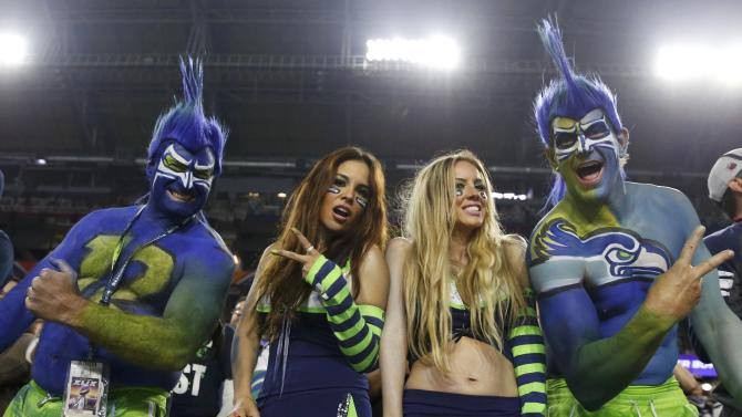 Seattle Seahawks fans cheer during the NFL Super Bowl XLIX football game against the New England Patriots in Glendale