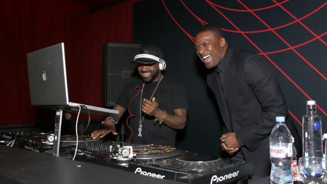 Jermaine Dupri and Chris Tucker attend at a Celebration of LA's Music Industry at the Getty House on Thursday, Feb. 7, 2013 in Los Angeles. (Photo by Todd Williamson/Invision/AP)