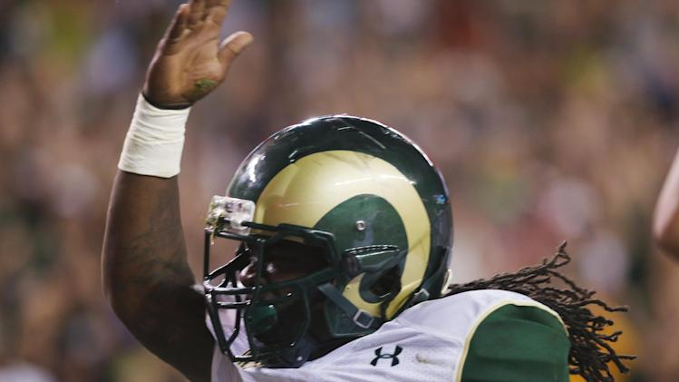 Colorado State running back Dee Hart celebrates after his touchdown run against Colorado in the second quarter of an NCAA college football game in Denver on Friday, Aug. 29, 2014. (AP Photo/David Zalubowski)