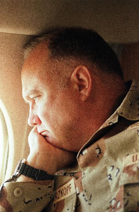 FILE - In this Jan. 13, 1991 file photo, General H. Norman Schwarzkopf, commander of U.S. troops in the Gulf, gazes from the window of his small jet on his way out to visit U.S. troops in the desert i