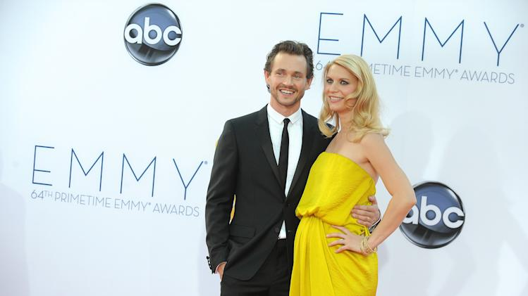 Actress Claire Danes, right and her husband Hugh Dancy arrive at the 64th Primetime Emmy Awards at the Nokia Theatre on Sunday, Sept. 23, 2012, in Los Angeles.  (Photo by Jordan Strauss/Invision/AP)