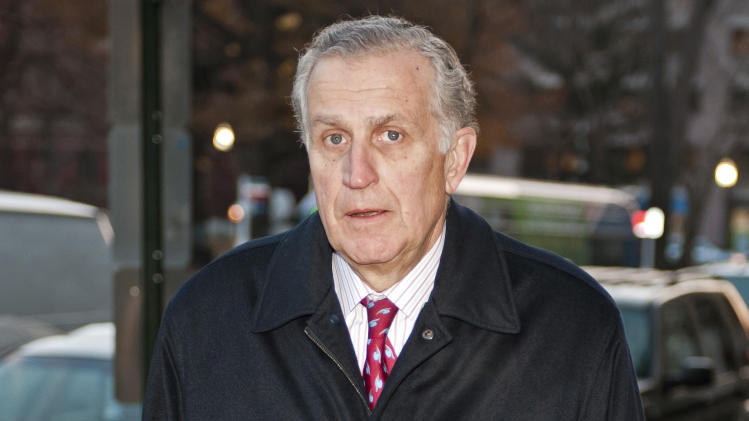 FILE - In this Nov. 30, 2012, file photo, former NFL commissioner Paul Tagliabue arrives at an attorney's office in Washington for a hearing on the bounty system of the New Orleans Saints NFL football team. Tagliabue, who was appointed to handle a second round of player appeals to the league, has informed all parties he planned to rule by Tuesday, Dec. 11_giving four players a ruling on whether their initial suspensions are upheld, reduced or thrown out. (AP Photo/Cliff Owen, File)