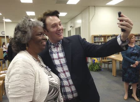 File photo of Democratic nominee Clay Aiken taking a pictures with a constituent after a campaign forum in Cary North Carolina