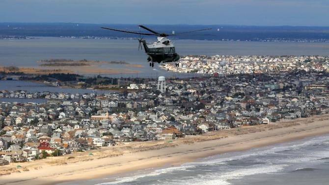 Marine One, carrying President Barack Obama and New Jersey Gov. Chris Christie,  take an aerial tour of the Atlantic Coast in New Jersey in areas damaged by superstorm Sandy, Wednesday, Oct. 31, 2012. (AP Photo/Doug Mills, Pool)