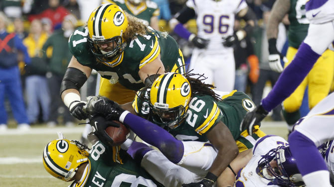 Green Bay Packers running back DuJuan Harris (26) dives into the end zone for a touchdown during the first half of an NFL wild card playoff football game against the Minnesota Vikings Saturday, Jan. 5, 2013, in Green Bay, Wis. (AP Photo/Jeffrey Phelps)