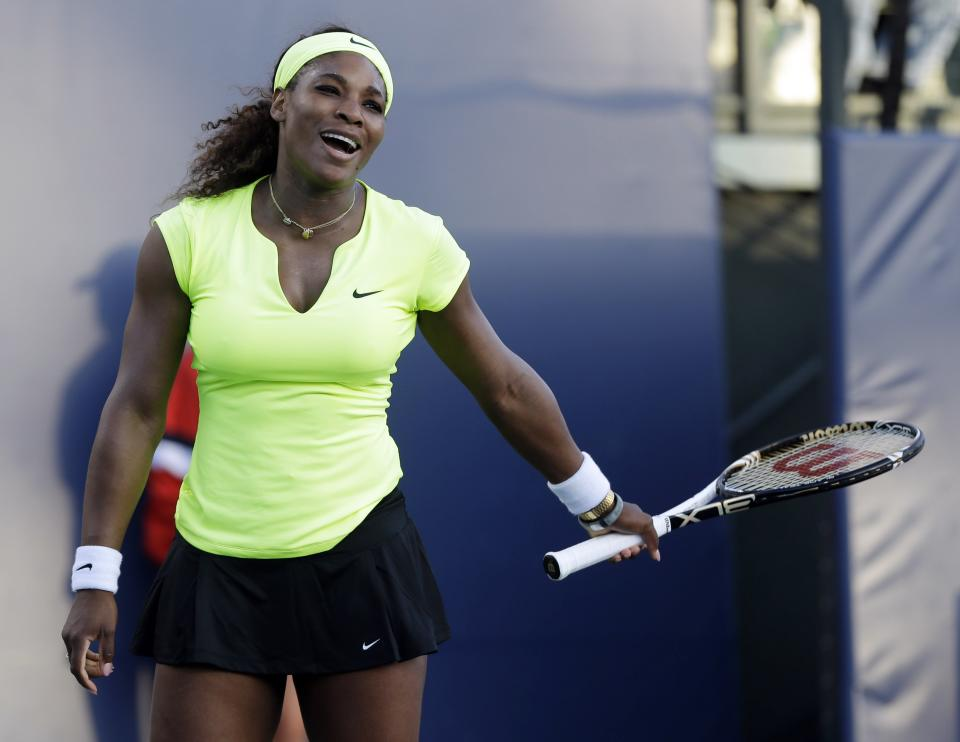 Serena Williams, of the United States, reacts as she plays Chanelle Scheepers, of South Africa, during a quarterfinal of the Bank of the West tennis tournament Friday, July 13, 2012, in Stanford, Calif. (AP Photo/Marcio Jose Sanchez)