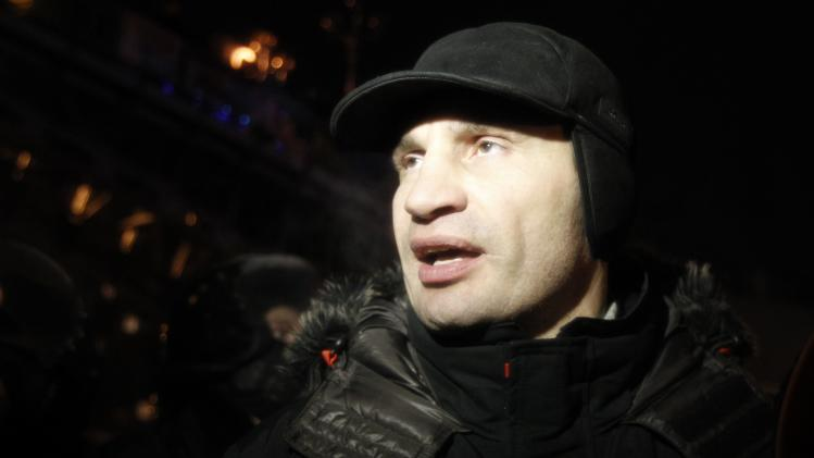 UDAR party leader Vitaly Klitschko walks past a riot police line in Kiev
