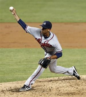 Delgado pitches Braves past Marlins 2-1