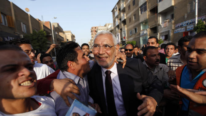 Egyptian presidential candidate Abdel-Moneim Abolfotoh is welcomed by his supporters while he arrives to a mass meeting in  Monofeya, about 70 Kilometers north of Cairo, Egypt, Thursday, April 26, 2012. A panel of fundamentalist Islamic clerics has endorsed the candidate of the Muslim Brotherhood for president of Egypt, an attempt to prevent a split of the conservative Muslim voters. The ultraconservative endorsement boosted the Brotherhood candidate, Mohammed Morsi, who faces competition in next month's election from a more moderate Islamist, Abdel-Moneim Abolfotoh, who broke ranks with the group.(AP Photo/Khalil Hamra)
