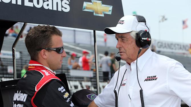 IndyCar driver AJ Allmendinger talks with team owner Roger Penske before a practice session for the Detroit Grand Prix auto tace on Belle Isle in Detroit, Friday, May 31, 2013. The Detroit Grand Prix will feature IndyCar's first attempt to have a pair of full-length auto races in the same weekend and unlike last year, Penske is confident the track will hold up. (AP Photo/Bob Brodbeck)