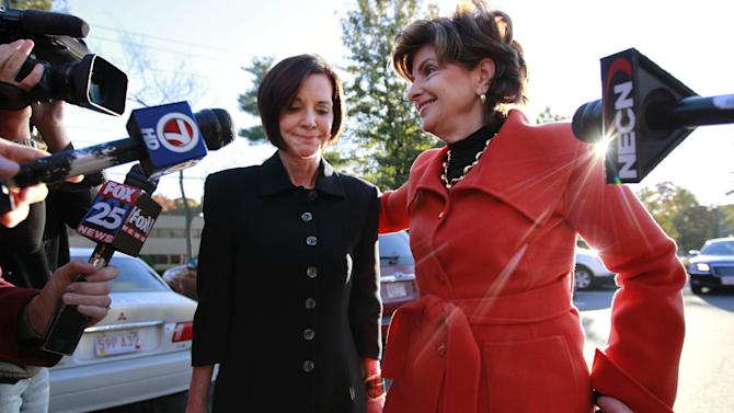 CORRECTS NAME TO MAUREEN SULLIVAN STEMBERG, NOT MAUREEN STEMBERG SULLIVAN - Maureen Sullivan Stemberg, left, ex-wife of Staples founder Tom Stemberg, and her lawyer Gloria Allred, right, face members of the media as they arrive at Norfolk County Probate Court Thursday, Oct. 25, 2012, in Canton, Mass. Lawyers for The Boston Globe are to return to court Thursday to argue for the public release of testimony given by GOP presidential candidate Mitt Romney in the divorce of Stemberg. Stemberg's ex-wife appeared in court with Allred and told the judge they do not object to lifting the impoundment order on Romney's testimony. (AP Photo/Steven Senne)