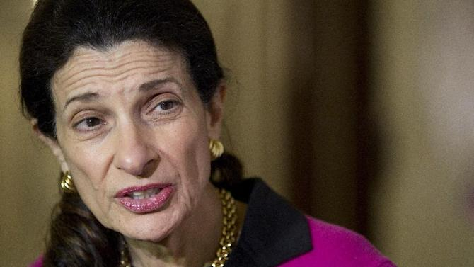 Sen. Olympia Snowe, R-Maine, speaks to media outside her office on Capitol Hill in Washington, Tuesday night, Feb. 28, 2012, about her decision not to run for re-election this fall. (AP Photo/Carolyn Kaster)
