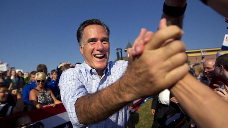 Republican presidential candidate, former Massachusetts Gov. Mitt Romney shakes hands as he arrives for a campaign rally on Saturday, Aug. 25, 2012 in Powell, Ohio.  (AP Photo/Evan Vucci)
